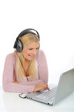 Pretty girl listening to the music with headphones Stock Photography