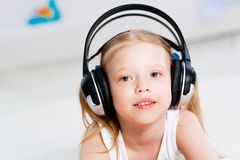 Pretty girl listening to music on headphones Royalty Free Stock Photography