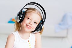 Pretty girl listening to music on headphones Stock Photos