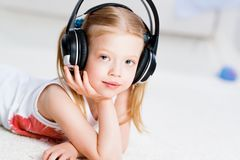Pretty girl listening to music on headphones Royalty Free Stock Images