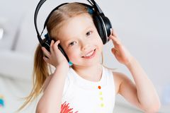 Pretty girl listening to music on headphones Stock Photo