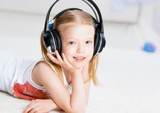 Pretty girl listening to music on headphones Royalty Free Stock Image