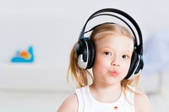 Pretty girl listening to music on headphones Royalty Free Stock Photos