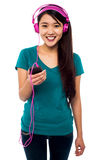 Pretty girl listening to music Stock Images