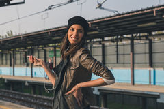 Pretty girl listening to music in a metro station Royalty Free Stock Photos