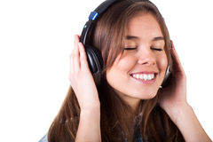 Pretty girl listening to music Stock Image