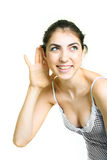Pretty girl listening to something royalty free stock images
