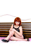 Pretty girl sitting on the bed Royalty Free Stock Photography