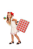 Pretty girl with lollipop and suitcase. Pretty little girl with large lollipop and vintage suitcase - isolated royalty free stock images