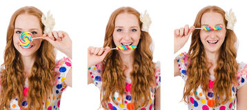 The pretty girl with lollypops isolated on white Royalty Free Stock Image