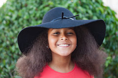 Pretty girl with long afro hair and black hat Stock Photography
