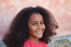 Pretty girl with long afro hair in the garden. Laughing royalty free stock images