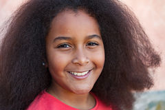 Pretty girl with long afro hair in the garden Royalty Free Stock Image