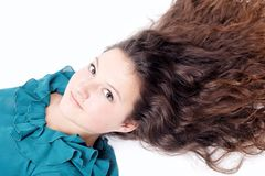 Pretty girl with long curly hair Stock Photography