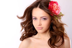 Pretty girl with long hair and flower-hairpin Royalty Free Stock Image
