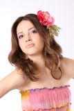Pretty girl with long hair and flower-hairpin Royalty Free Stock Images