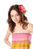 Pretty girl with long hair and flower-hairpin Stock Photo