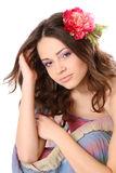Pretty girl with long hair and flower-hairpin Royalty Free Stock Photo