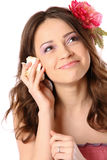 Pretty girl with long hair and flower-hairpin Stock Images