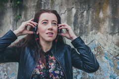 Pretty girl with long hair listening to music Stock Photography