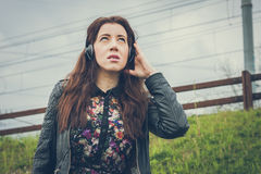 Pretty girl with long hair listening to music Royalty Free Stock Photos