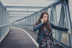 Pretty girl with long hair talking on phone Royalty Free Stock Images