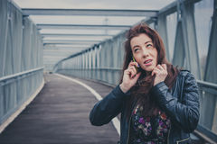 Pretty girl with long hair talking on phone Royalty Free Stock Photo