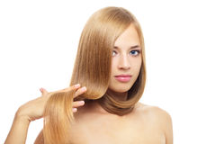 Pretty girl with long hair on white Stock Photos