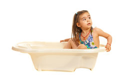 Pretty girl looking back in a bathtub stock image
