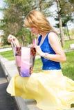Pretty girl looking into bag Stock Photos