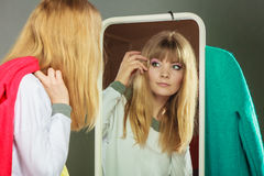 Pretty girl looking into mirror. Royalty Free Stock Photo