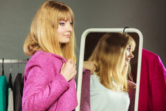 Pretty girl looking into mirror. Royalty Free Stock Image