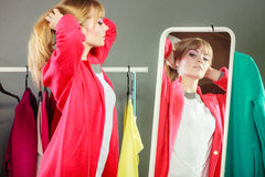 Pretty girl looking into mirror. Stock Images