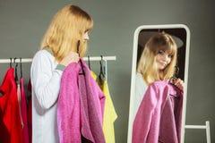 Pretty girl looking into mirror. Stock Photos