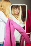 Pretty girl looking into mirror. Royalty Free Stock Photos