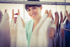 Pretty girl looking trough the wardrobe Royalty Free Stock Image
