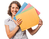 Pretty girl with a lot of paper folders Royalty Free Stock Images