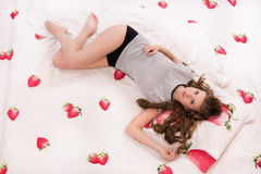 Pretty girl lying on the bed Royalty Free Stock Images