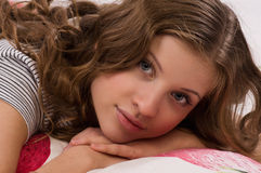 Pretty girl lying on the bed Royalty Free Stock Photo