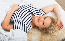 Pretty girl lying in bed with opened yes Stock Images
