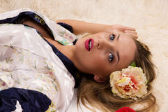 Pretty girl lying on the floor Royalty Free Stock Image