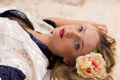 Pretty girl lying on the floor Stock Photos