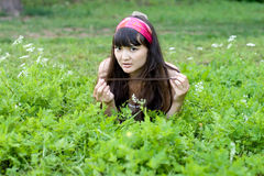 Pretty girl lying on grass Stock Images