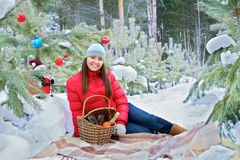 Pretty girl lying on mat in winter forest Stock Photo