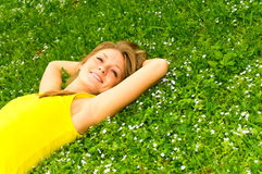 Pretty girl lying on meadow Royalty Free Stock Photography