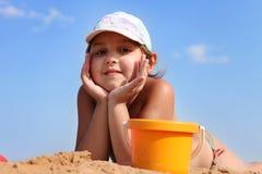 Pretty girl lying on sand Stock Photography