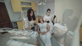Pretty girl lying on teeth cleansing treatment. 4K.  stock video footage
