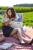 Pretty girl make a picnic Royalty Free Stock Photos