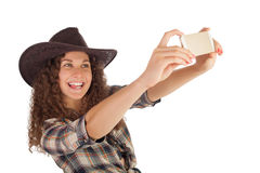 Pretty girl make a self portrait with her smartphone. Stock Photography