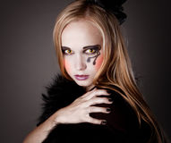 Pretty girl makeup as a witch. For Halloween is looking straight Royalty Free Stock Images